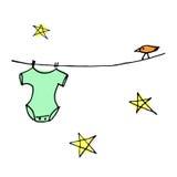 Grüne Babyausstattung auf Wäscheleine mit Vogel Stockbild