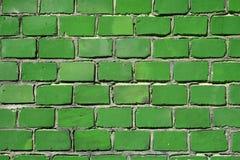 Grüne Backsteinmauer stockfotos