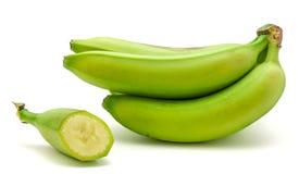 Grüne Banane der Banane lokalisiert Stockfotografie