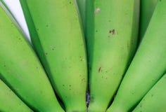 Grüne Banane im Abschluss hohe und Hintergrundbeschaffenheiten Lizenzfreie Stockfotos