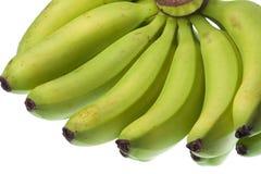Grüne Bananen getrennt Stockfoto