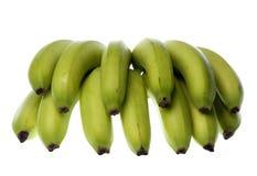 Grüne Bananen getrennt Stockbilder
