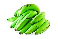 Grüne Bananen getrennt auf weißem Hintergrund Stockbild