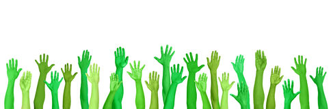 Grüne bewusste umweltsmäßighände angehoben Stockfoto