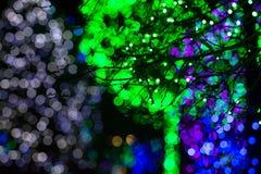 Grüne, blaue u. weiße Bokeh-Lichter Stockfotos