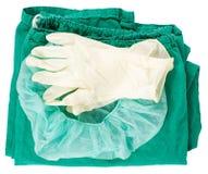 Grüne chirurgische Kleidung und Handschuhe Lizenzfreies Stockfoto