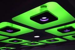 Grüne dekorative flippige farbige Leuchten Stockbilder