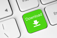 Grüne Downloadtastaturtaste Lizenzfreie Stockfotografie