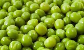 Grüne Erbsen Stockfotos