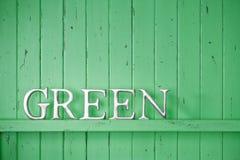 Grüne Farbwort-Hintergrund Stockfotografie