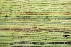 Grüne Fußbodenmatte mit brauner Streifenbeschaffenheit Stockbilder