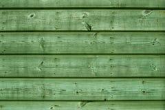 Grüne hölzerne Vorstände stockfoto