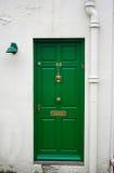 Grüne Haustür Stockbild