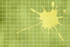 Grüne Hintergrundbeschaffenheit mit gelbem Spritzen Stockfoto