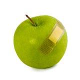 Grüne hinzugefügtes Bluten Apples Aufkleber auf Weiß Stockfotografie