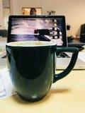 Grüne Kaffeetasse Stockbilder