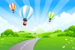 Grüne Landschaft mit Ballonen Stockfotografie