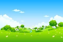 Grüne Landschaft mit Häusern Stockbild