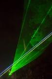 Grüne Laserstrahlen Stockbilder
