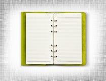 Grüne lederne Abdeckung des Tagebuchisolats ist auf weißem Hintergrund Lizenzfreies Stockfoto