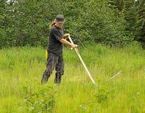Grüne Methode, den Rasen zu mähen Stockbild