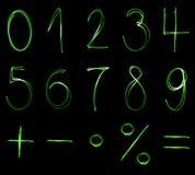 Grüne Neonzahlen Lizenzfreie Stockfotos