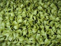 Grüne Nudeln des Hintergrundes Lizenzfreies Stockfoto