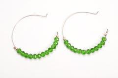 Grüne Ohrringe stockbild