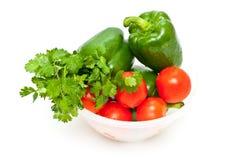 Grüne Pfeffer, Petersilie und Tomaten Stockfotografie