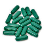 Grüne Pillen Lizenzfreie Stockfotografie