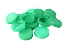 Grüne Plastikflaschenoberteile Stockfoto
