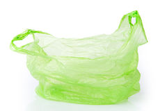 Grüne Plastiktasche lokalisiert Stockfotos