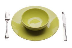 Grüne Platte mit Geschirren Stockfotografie