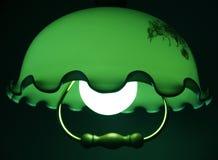 Grüne ruhige Leuchte einer Lampe Stockfotografie