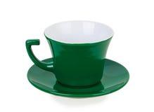 Grüne Schale auf grüner Untertasse Lizenzfreies Stockbild
