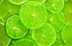 Grüne Scheiben des Kalkhintergrundes Stockbild