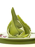 Grüne Serviette auf weißem Hintergrund Stockfoto