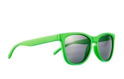 Grüne Sonnenbrillen lokalisiert Stockfoto