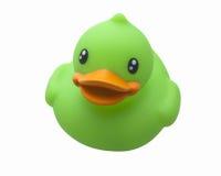 Grüne Spielzeug-Gummi-Ente stockfotos