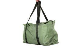 Grüne Tasche lokalisiert über weißem Hintergrund Stockfoto