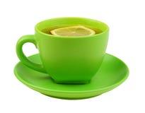Grüne Tasse Tee mit Zitrone Stockfotografie
