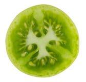 Grüne Tomate auf weißem Hintergrund Stockfotografie