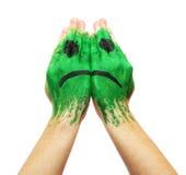 Grüne traurige Lächelnschablone gemalt Lizenzfreie Stockfotos