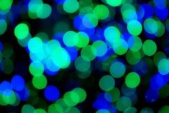 Grüne u. blaue Bokeh-Lichter stockbild