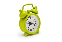 Grüne Uhr Stockbild