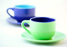 Grüne und blaue Espresso-Kaffeetassen Lizenzfreie Stockfotografie