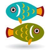 Grüne und blaue Fische auf einem weißen Hintergrund Stockfotos