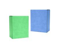 Grüne und blaue Pappschachteln Stockfotos