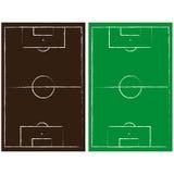Grüne und braune Fußballplätze Stockbild