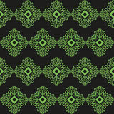 Grüne Verzierung auf einem schwarzen backgroun Stockbild